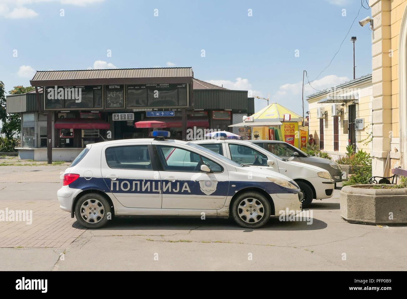 Serbian police car at the original historic railway station, Belgrade, Serbia - Stock Image