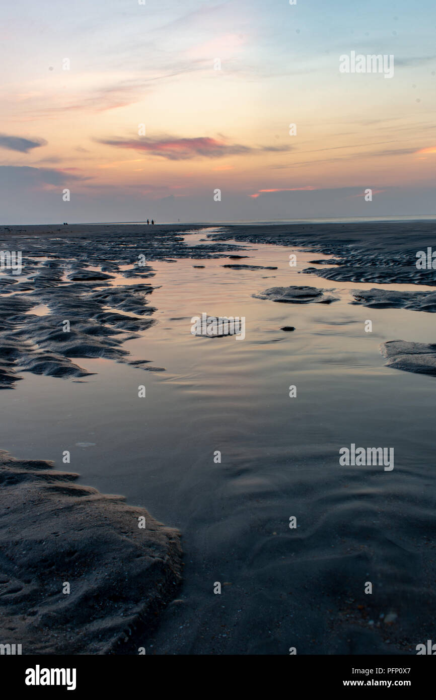 Tide pool leading into the sunrise at South Carolina - Stock Image