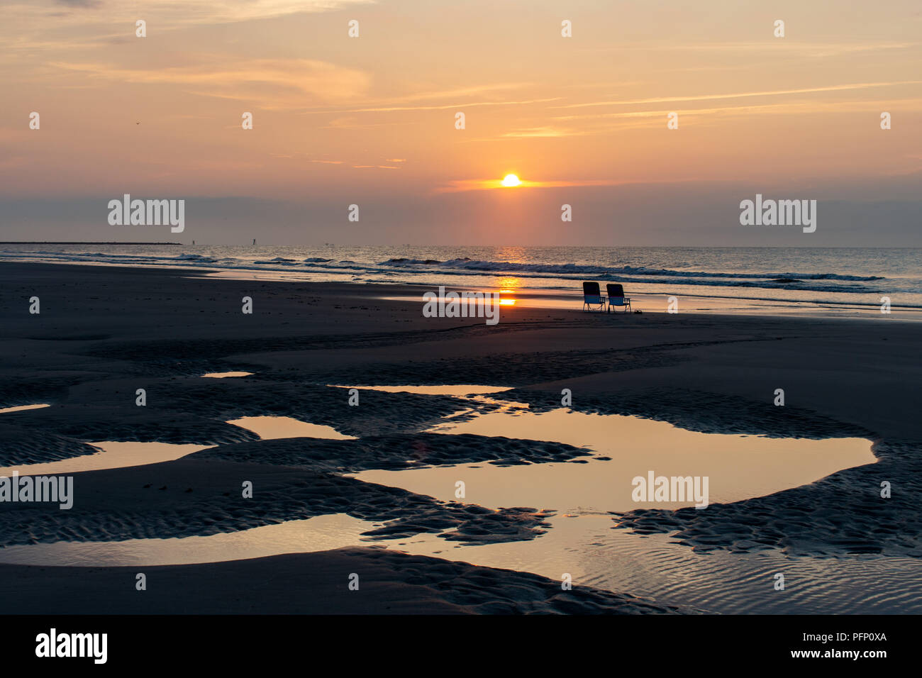 Two beach chairs at sunrise in South Carolina - Stock Image