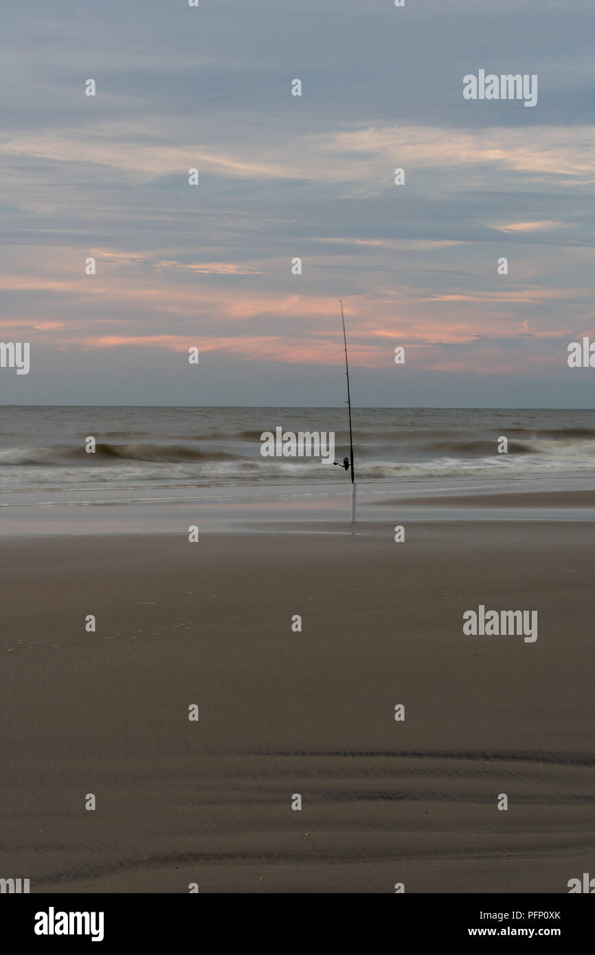 Minimalist shot of a fishing pole at sunrise in South Carolina - Stock Image