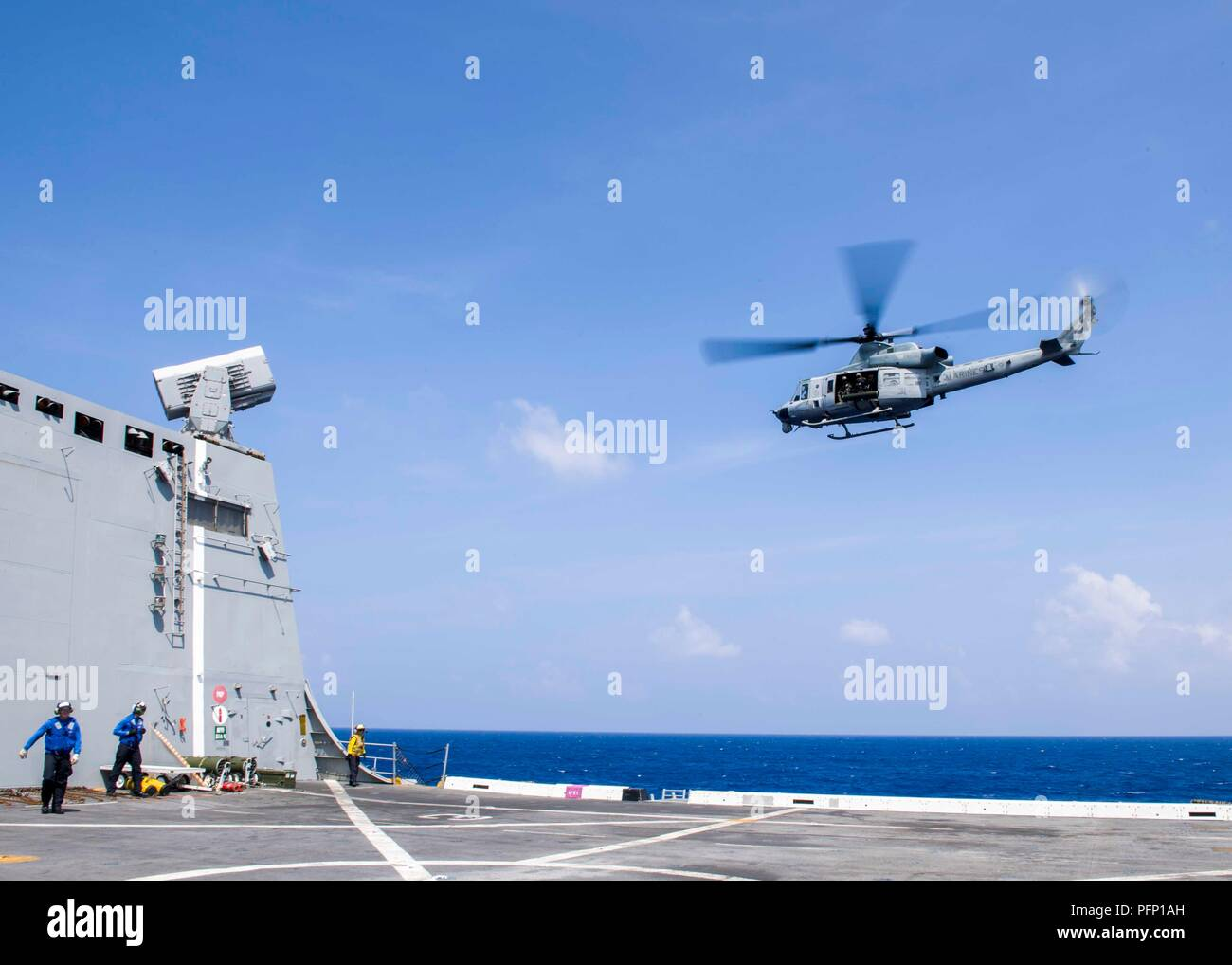 180808-N-PH222-0514 PACIFIC OCEAN (August 8, 2018) A UH-1Y Venom helicopter, assigned to the Marine Light Attack Helicopter detachment of Marine Medium Tiltrotor Squadron (VMM) 166, conducts flight operations from the flight deck of San Antonio-class amphibious transport dock USS Anchorage (LPD 23) during a regularly scheduled deployment of the Essex Amphibious Ready Group (ARG) and 13th Marine Expeditionary Unit (MEU). The Essex ARG/MEU team is a strong and flexible force equipped and scalable to respond to any crisis ranging from humanitarian assistance and disaster relief to contingency ope - Stock Image