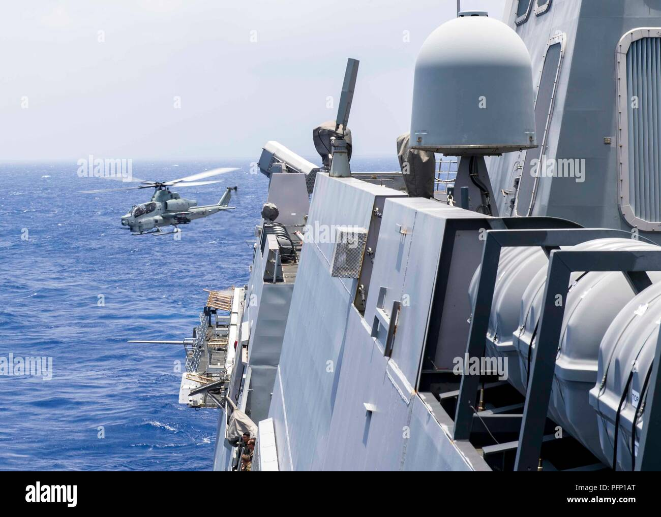 180809-N-PH222-0039 PACIFIC OCEAN (August 9, 2018) A AH – 1Z Viper helicopter, assigned to the Marine Light Attack Helicopter detachment of Marine Medium Tiltrotor Squadron (VMM) 166, departs the flight deck of San Antonio-class amphibious transport dock USS Anchorage (LPD 23) during a regularly scheduled deployment of the Essex Amphibious Ready Group (ARG) and 13th Marine Expeditionary Unit (MEU). The Essex ARG/MEU team is a strong and flexible force equipped and scalable to respond to any crisis ranging from humanitarian assistance and disaster relief to contingency operations. (U.S. Navy ph - Stock Image