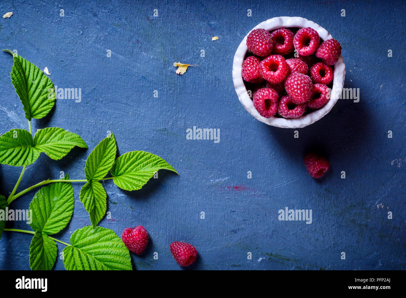 Raspberry with leaves, fresh organic healthy food. Top view, copy space. - Stock Image