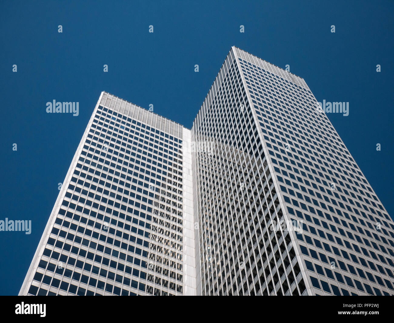 Abstract and Complex Blue Skyscraper Structure Downtown in Montreal with Sky in Background Stock Photo