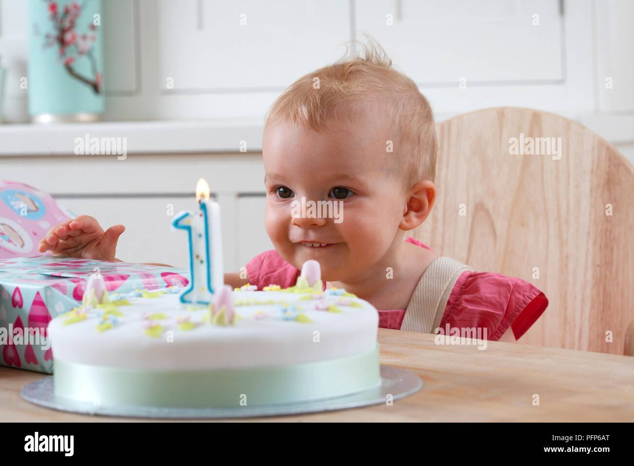 Groovy Baby Girl Sitting At Table Looking At 1St Birthday Cake Stock Funny Birthday Cards Online Hendilapandamsfinfo