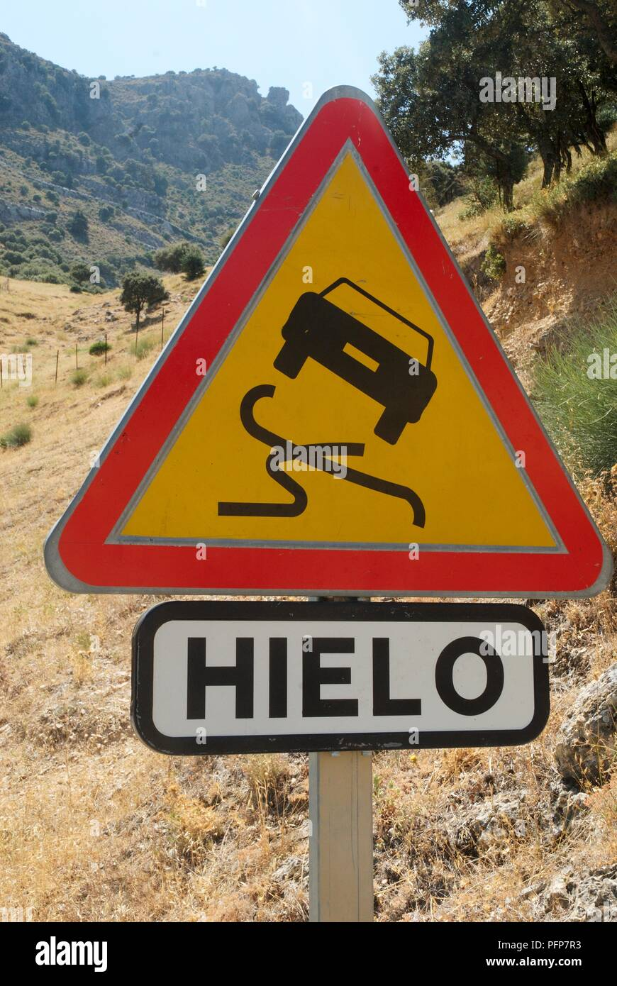 Spain, slippery road sign, close-up - Stock Image