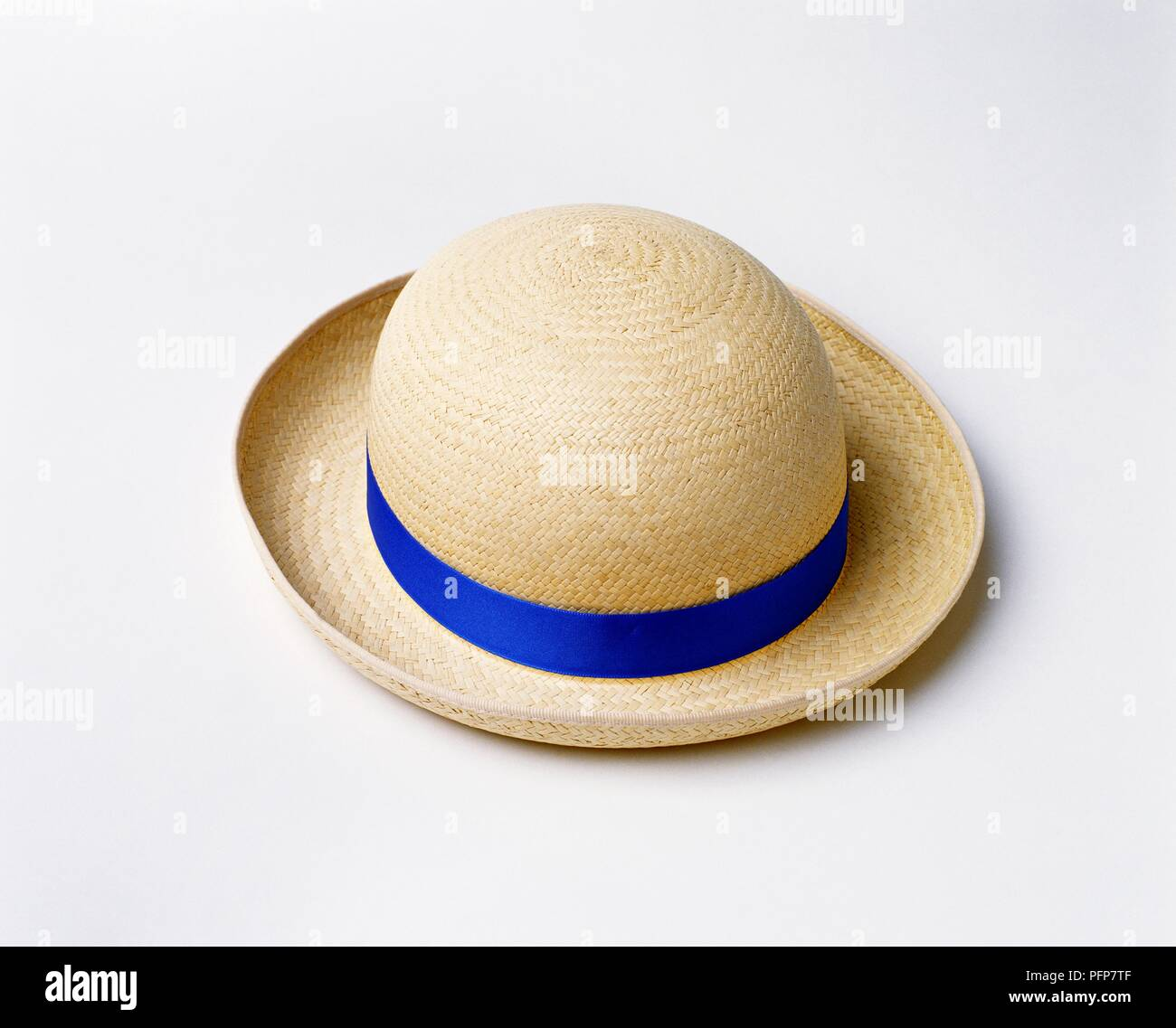 Girls straw boater with blue ribbon - Stock Image