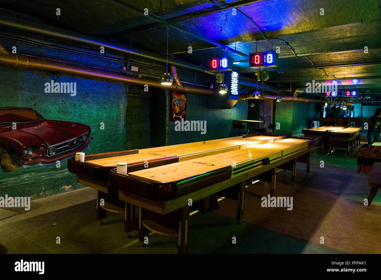 Shuffleboard table at a bar (Ugglan Boule & Bar, Sodermalm, Stockholm, Sweden) - Stock Image