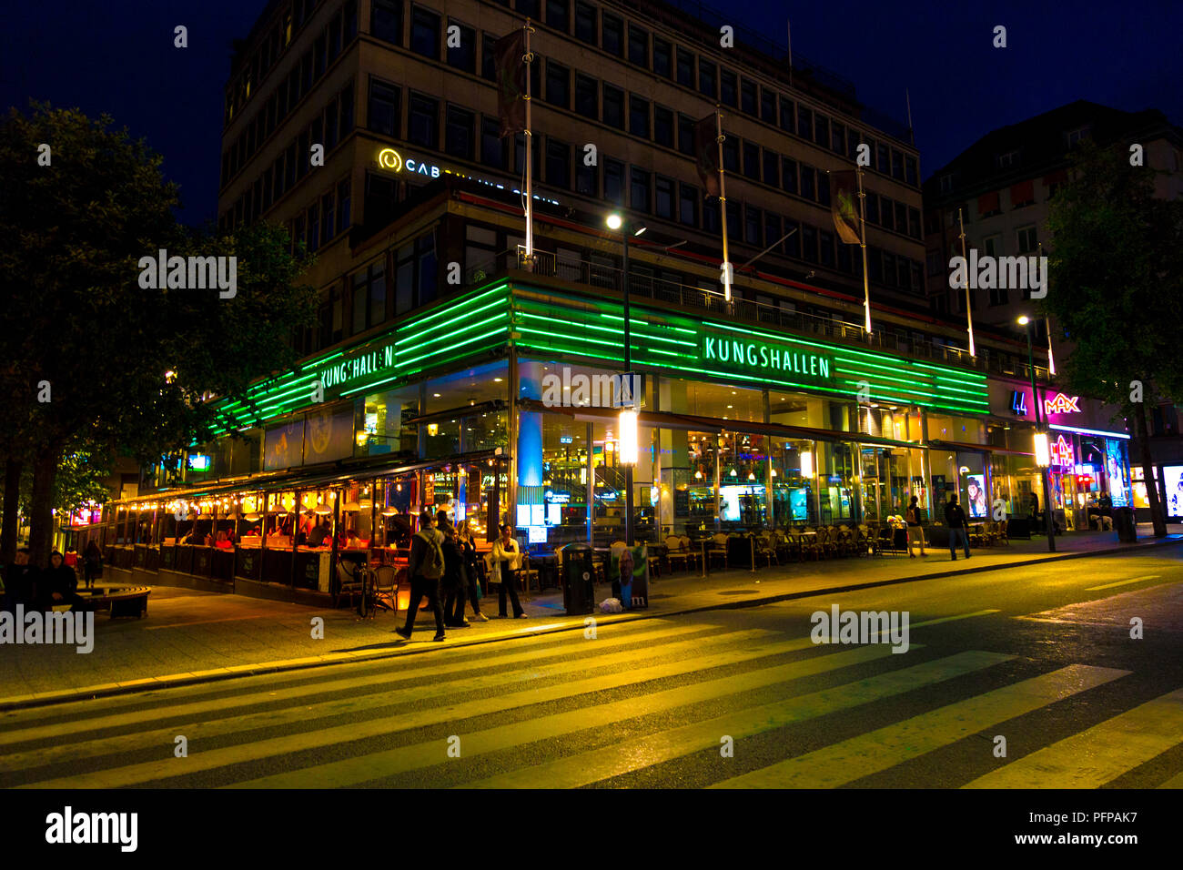 Exterior of Kungshallen food court at night time in Stockholm, Sweden - Stock Image