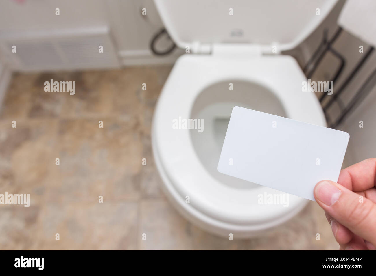Holding Blank Card Credit Membership Coupon Drivers License Into Toilet Bright And Clean Finance Concept