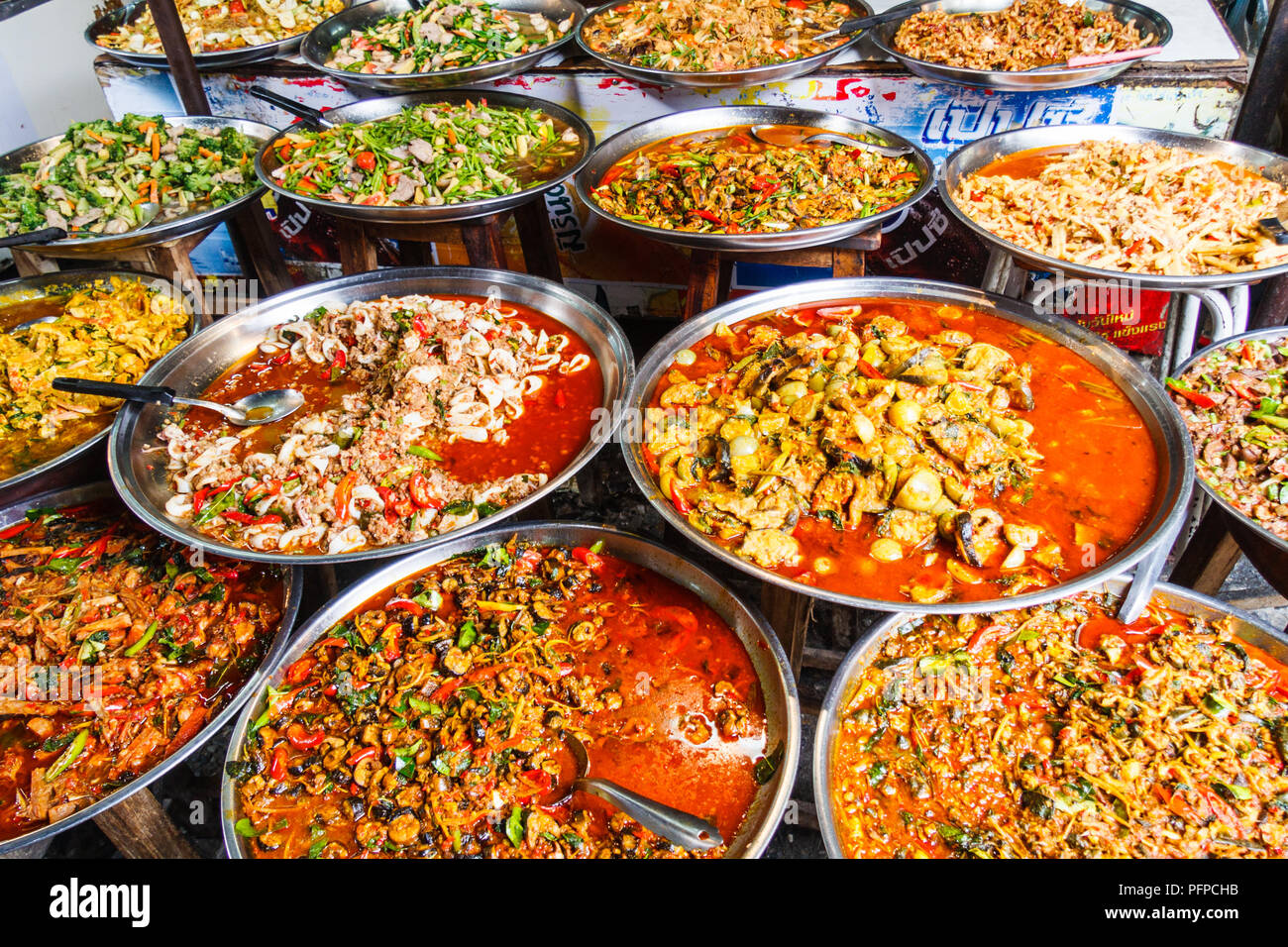 Platters of traditional Thai food for sale on street market stall, Bangkok, Thailand - Stock Image