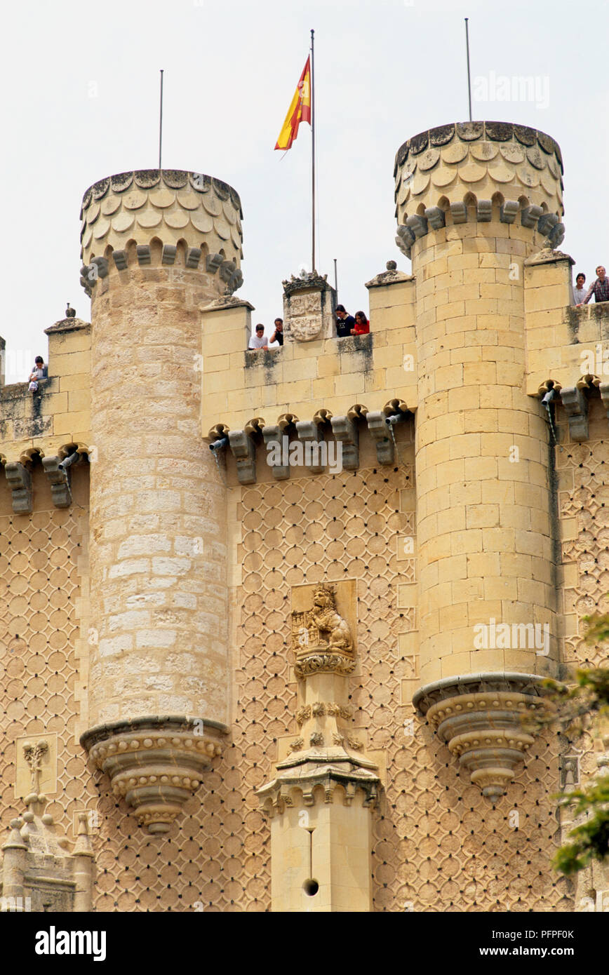 Spain, Segovia cathedral, visitors on gothic battlements - Stock Image