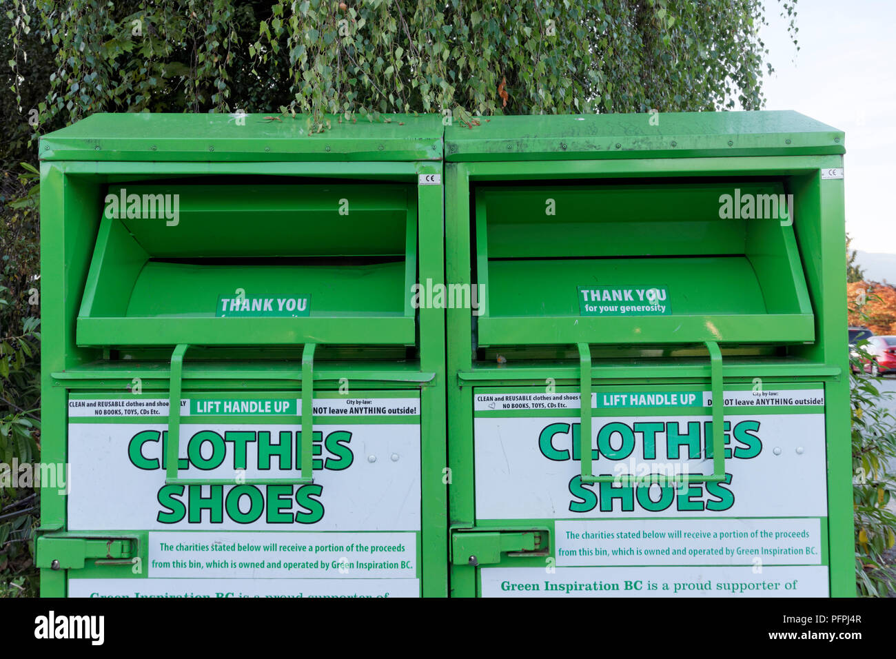 Clothing and shoes charitable collection box in Vancouver, BC, Canada - Stock Image
