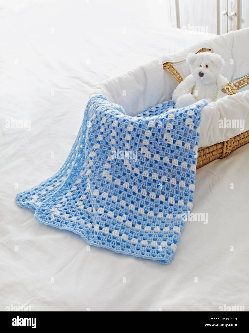 Crocheted Baby Blanket Draped Over Side Of Moses Basket Stock Photo Alamy