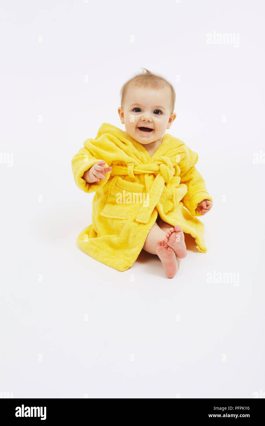 Baby at bathtime (Model age - 8 months) - Stock Image