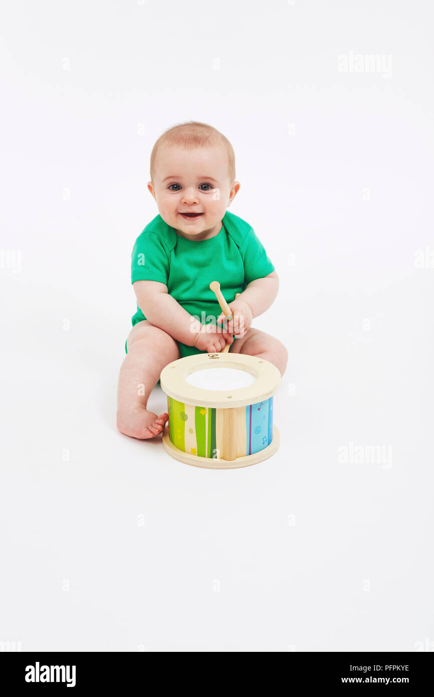 Musical baby (Model age - 8 months) - Stock Image
