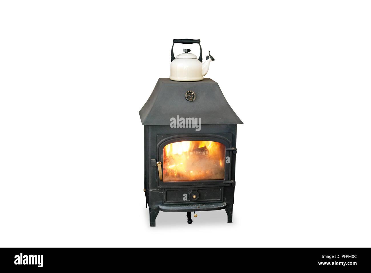 Kettle on wood-burning stove - Stock Image