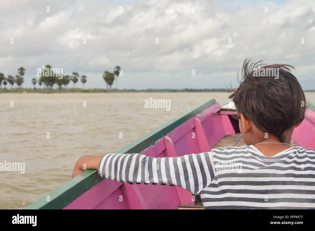 Young tourist contemplating the landscapes of lake Tempe in the south of Sulawesi, Indonesia - Stock Image