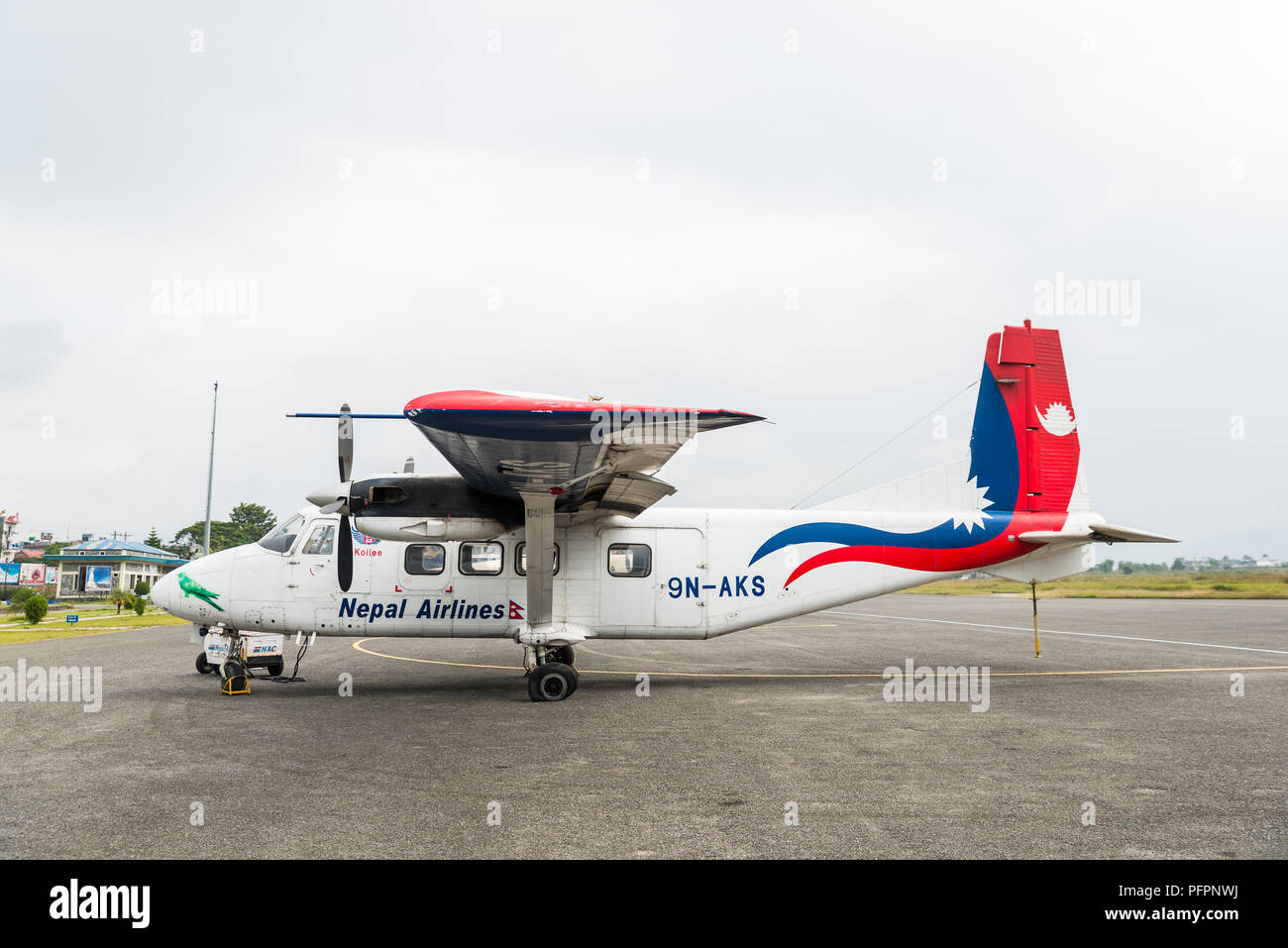 POKHARA, NEPAL - CIRCA OCTOBER 2017: A Nepal Airlines Harbin Y-12E airplane at Pokhara Airport. The rear left tyre seems to be punctured. - Stock Image