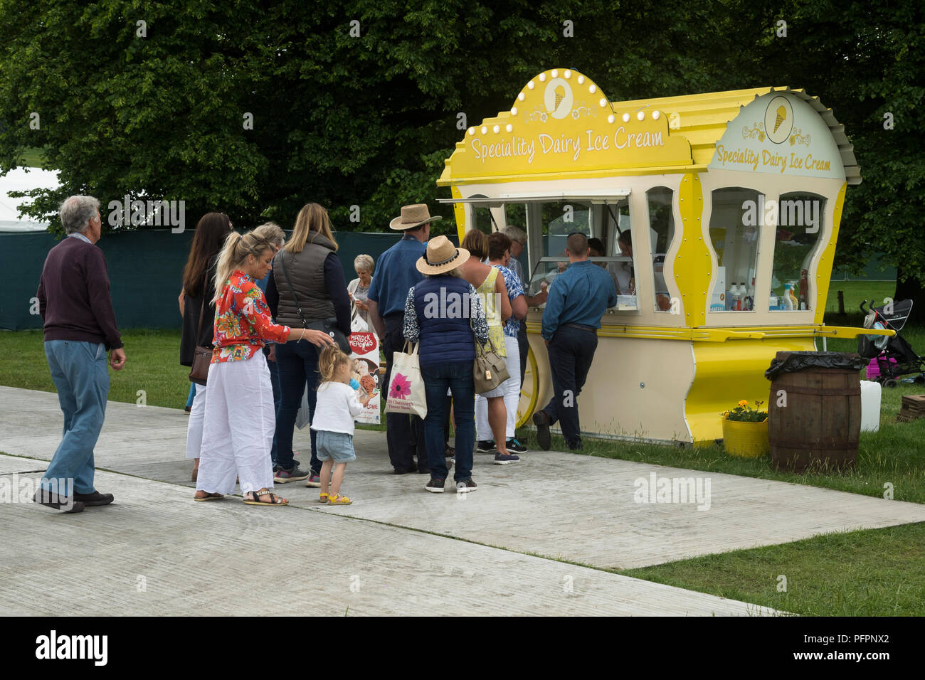 People old & young, queuing for speciality ice creams at vintage style mobile catering hut - RHS Chatsworth Flower Show, Derbyshire, England, UK. - Stock Image