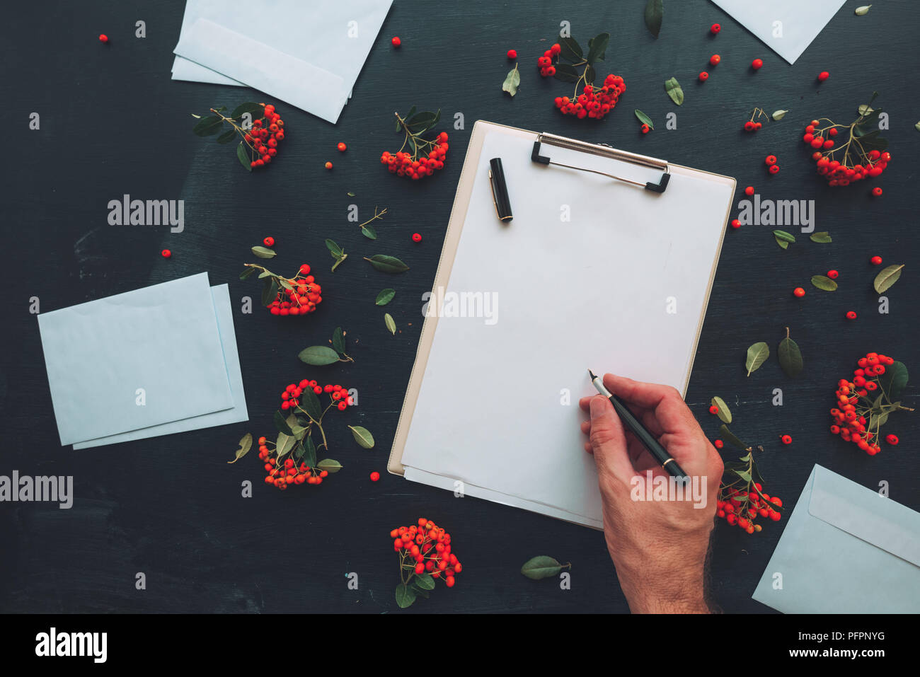 Flat Lay Hand Writing Letter On Clipboard Notepad And Mail Envelope