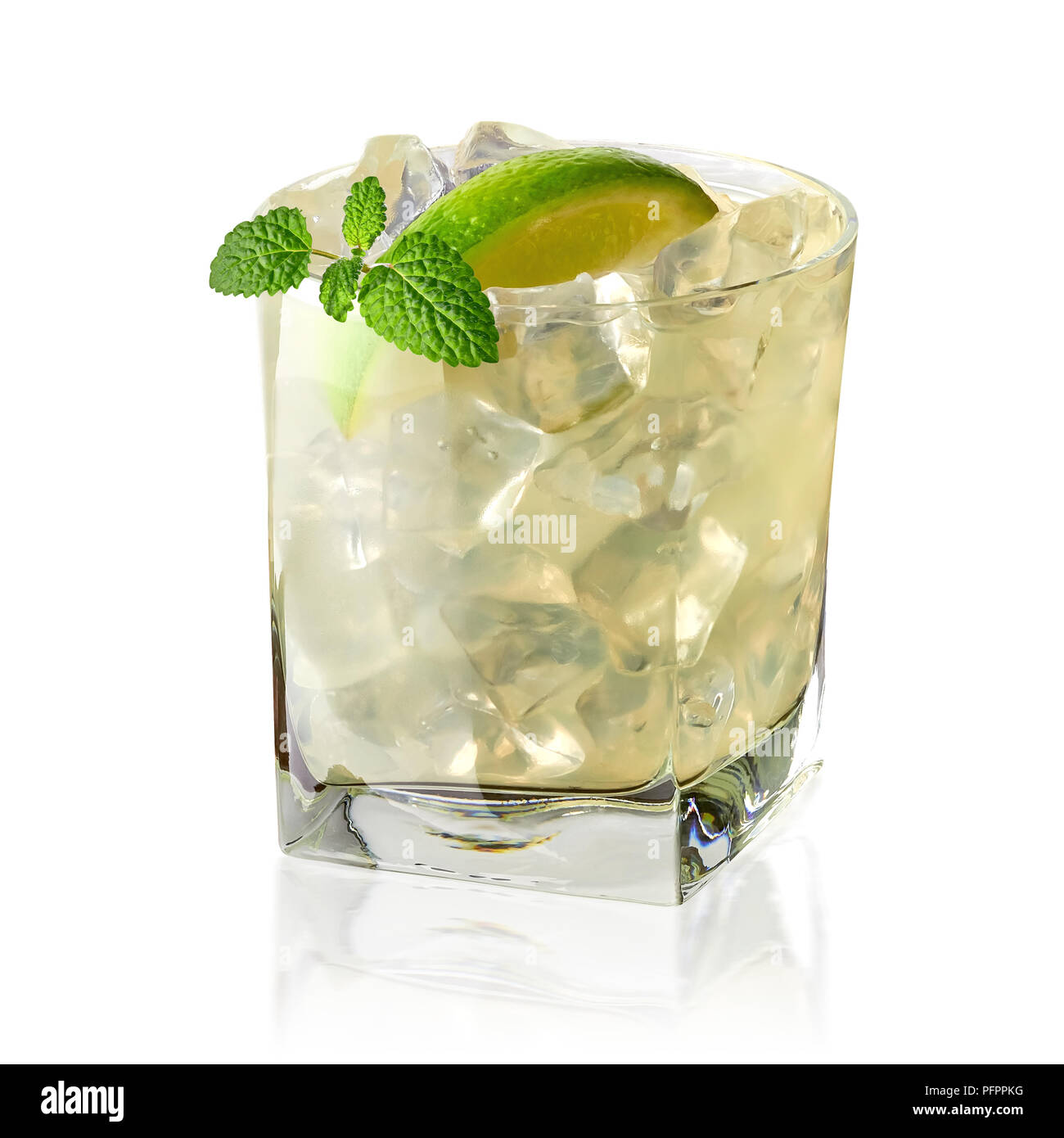 Vodka lime, gimlet or gin tonic with ice in glass on white background including clipping path - Stock Image
