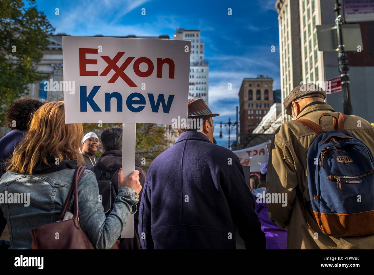 New York City, USA.  29th November, 2015:  A woman holds up a sign during the global climate change march in New York City, USA. Stock Photo
