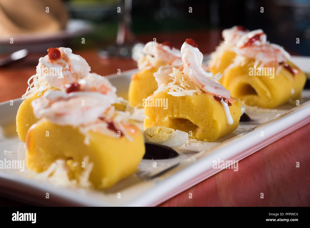 Peruvian Food: Causa Rellena, A smashed popatoes filled with crab meal. - Stock Image