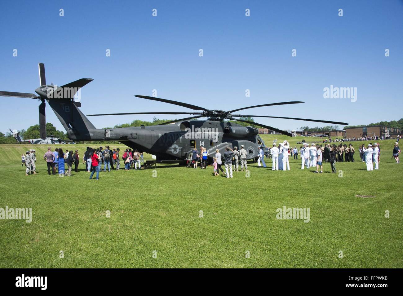 N J  (May 24, 2018) Students and faculty tour an MH-53 Sea