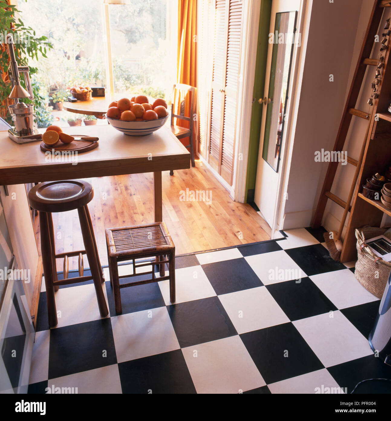 Kitchen and dining area with two different types of flooring ...