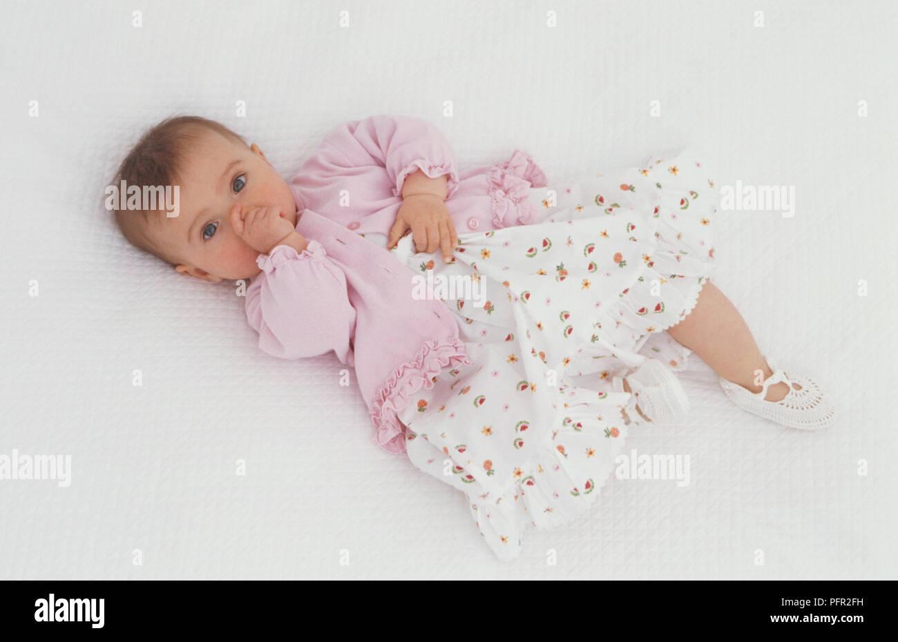 wearing pink cardigan, floral print