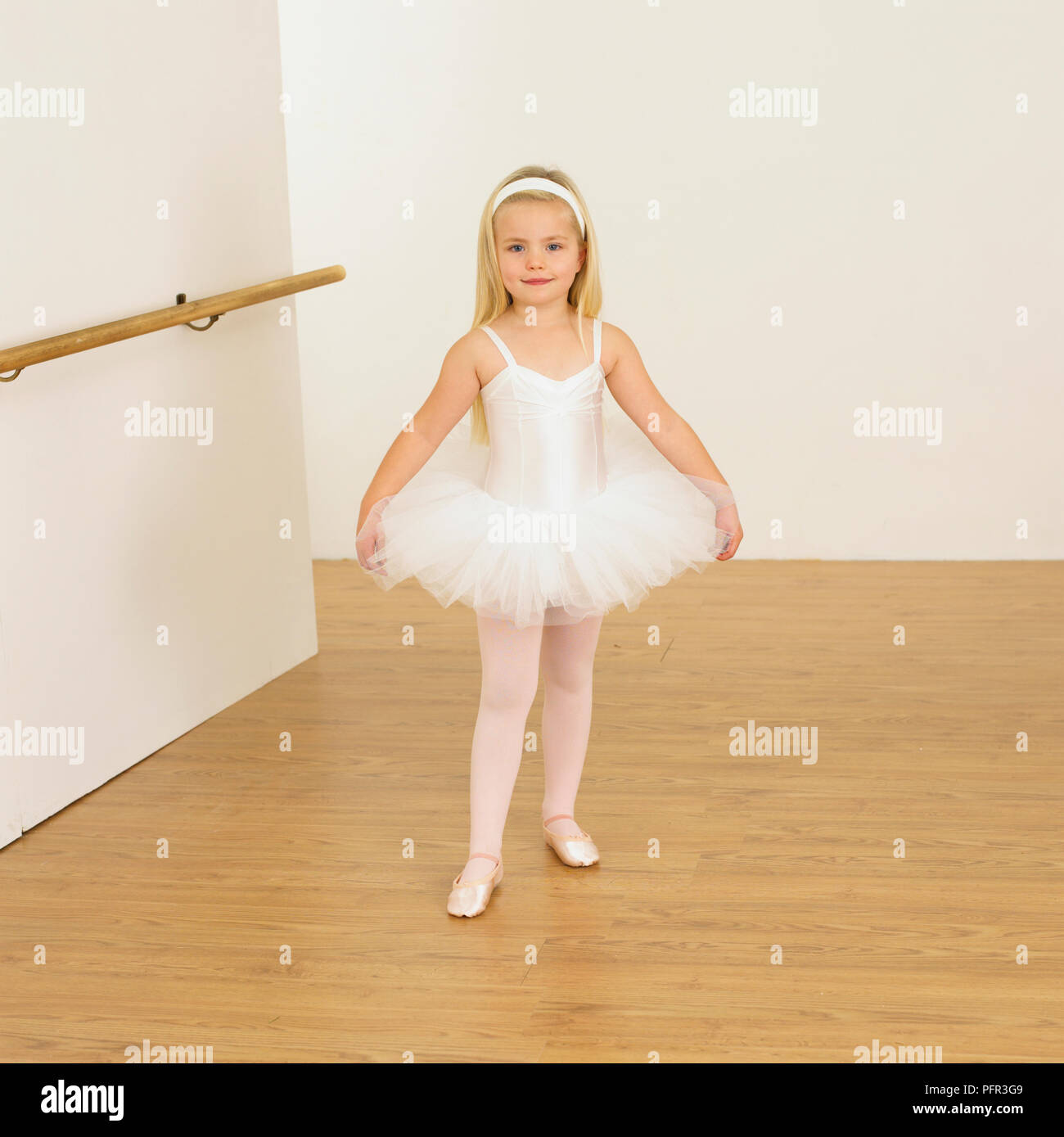 e095b5b29056 Girl wearing ballerina outfit showing first position