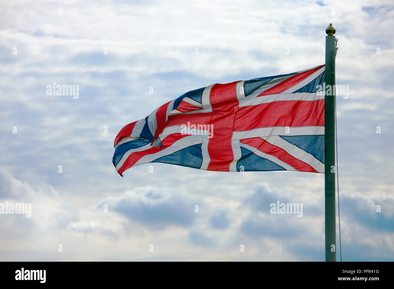 Union Jack against cloudy sky, close-up - Stock Image