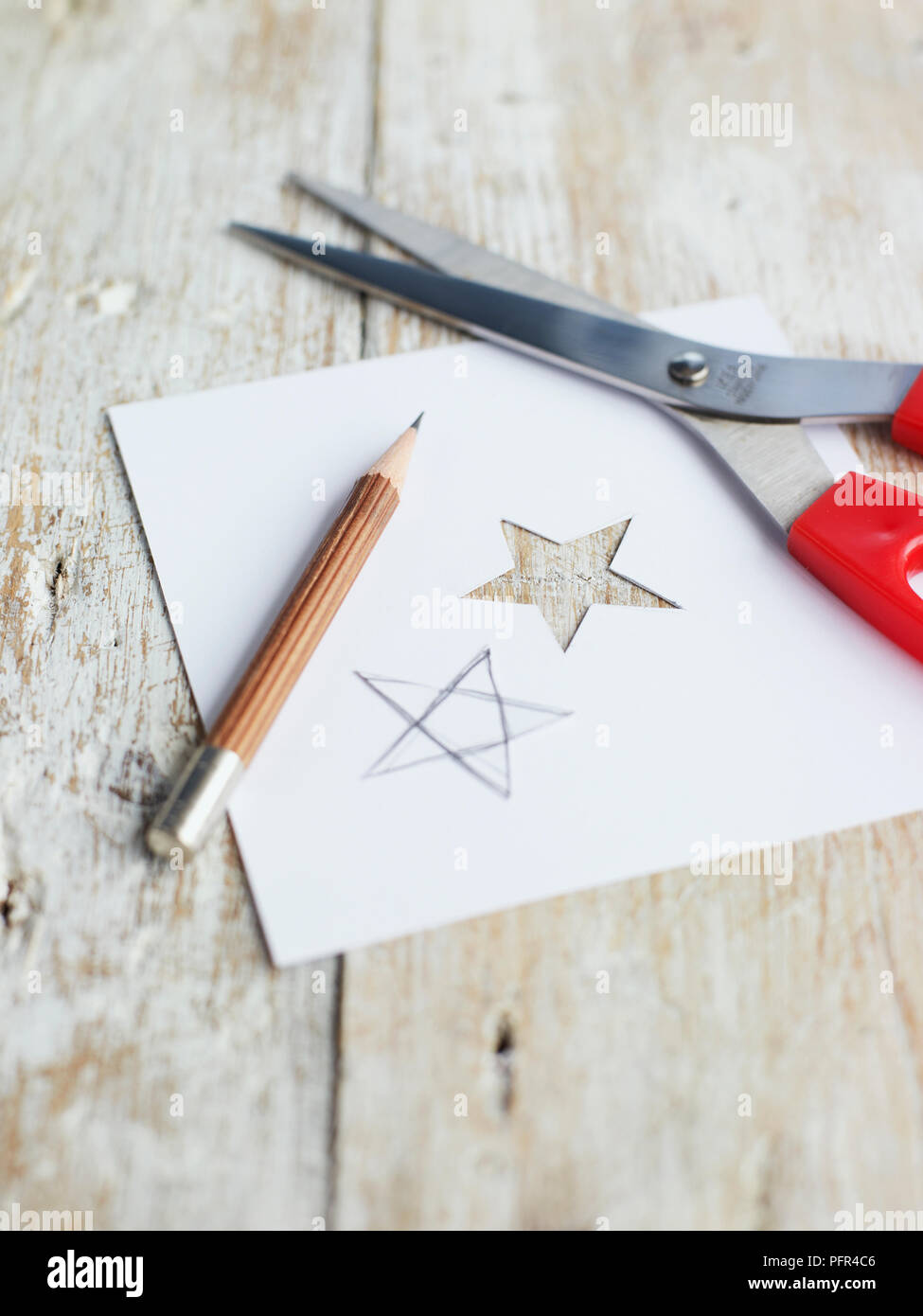Star Shape Drawn On Piece Of Card And Cut Out