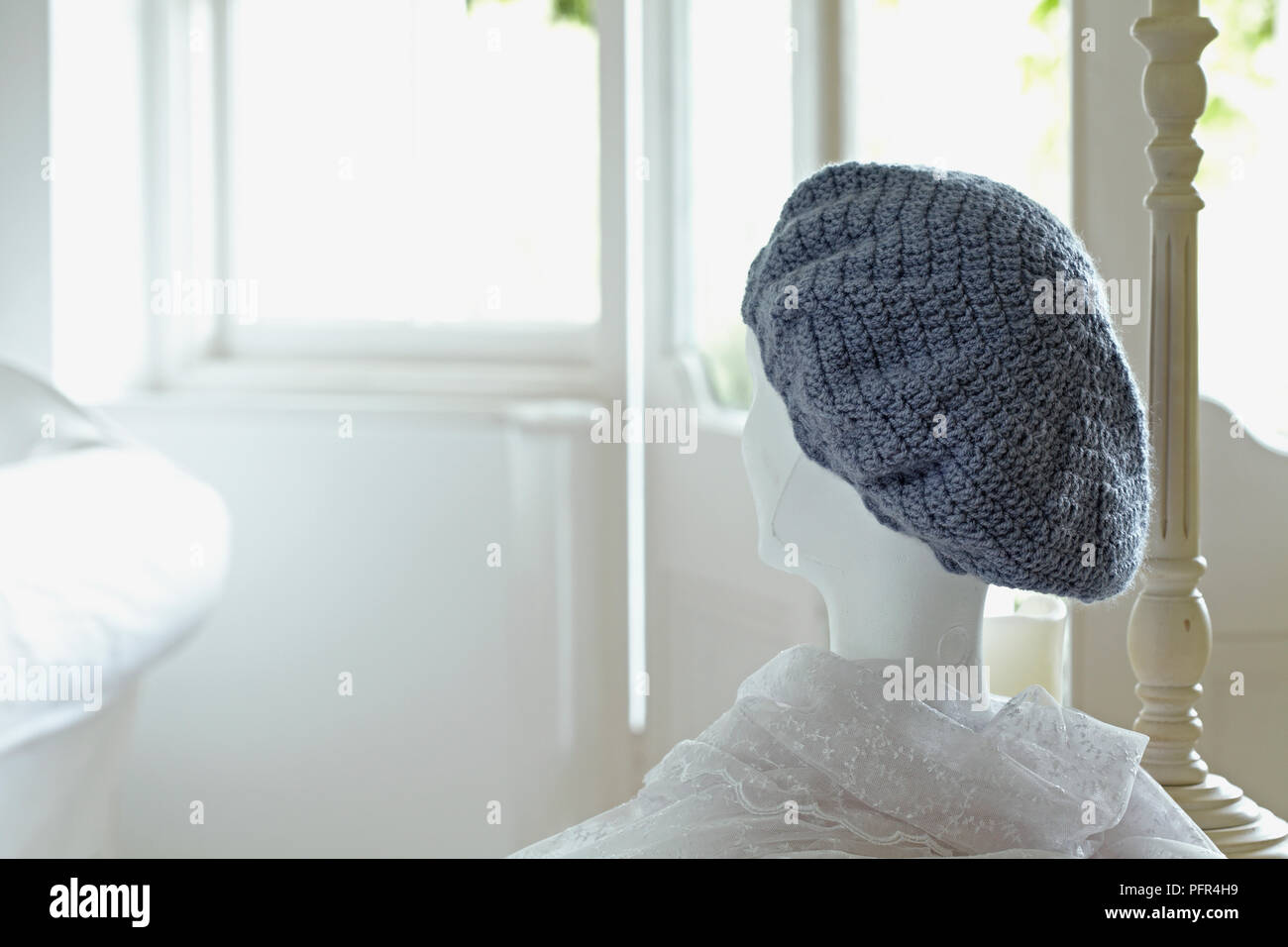 825b76f0109 Crocheted slouchy hat on dressmaker s mannequin Stock Photo ...