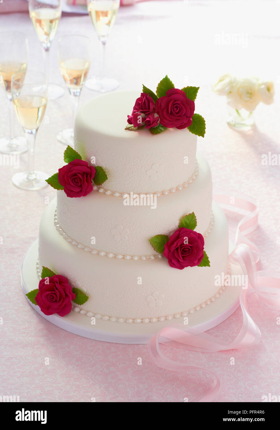 Three Tiered Traditional Wedding Cake With Rose Decorations Stock