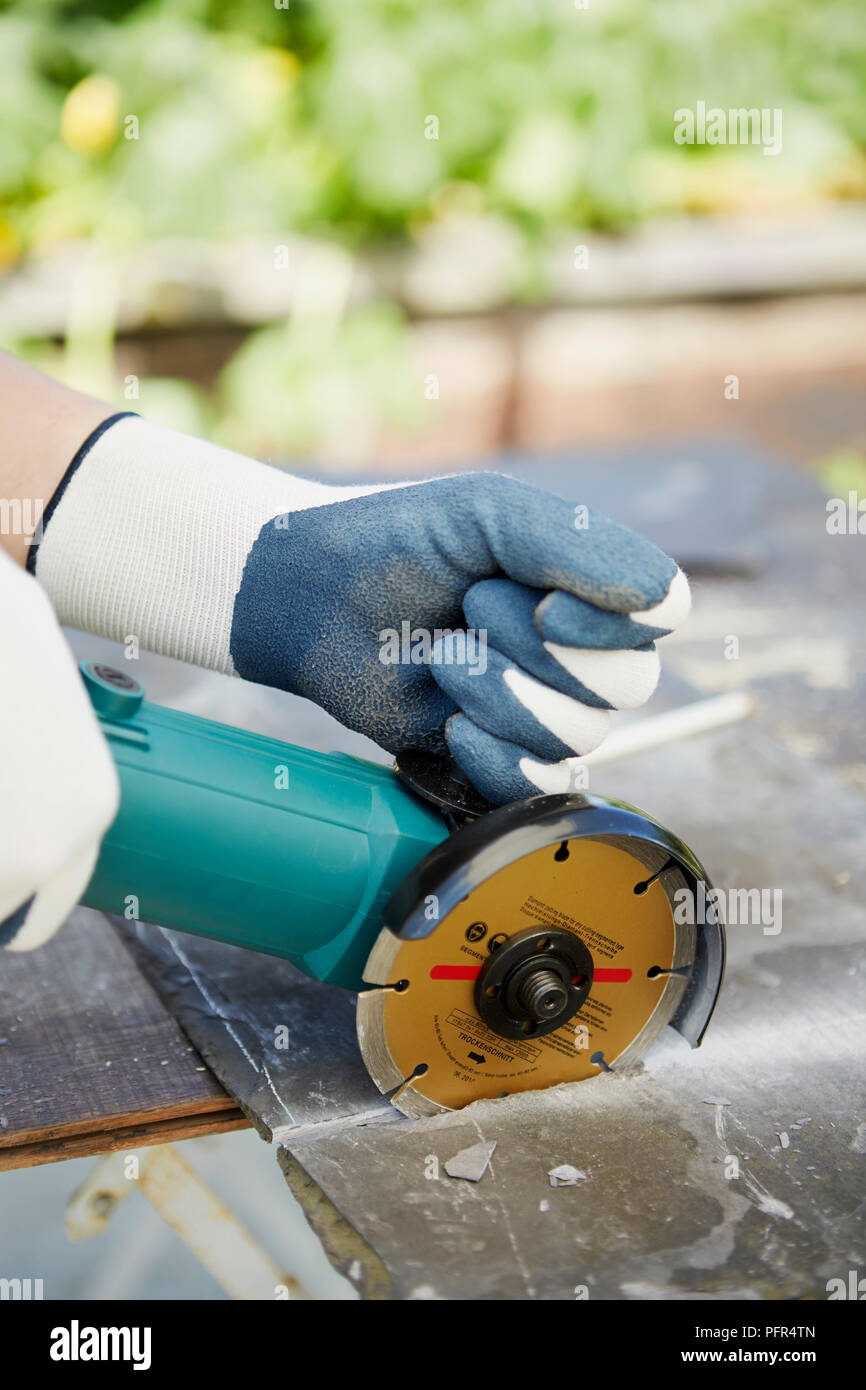 Making slate box planter, cutting out slate pieces with angle grinder - Stock Image