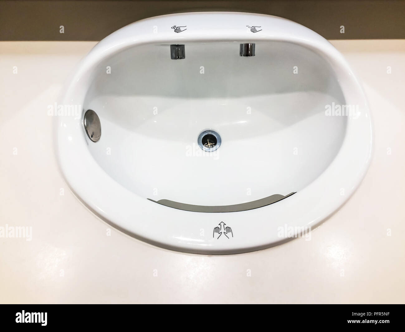 Hand basin automatic can be used hand blowers wind and soap at bathroom in modern international airport for service all passengers. - Stock Image