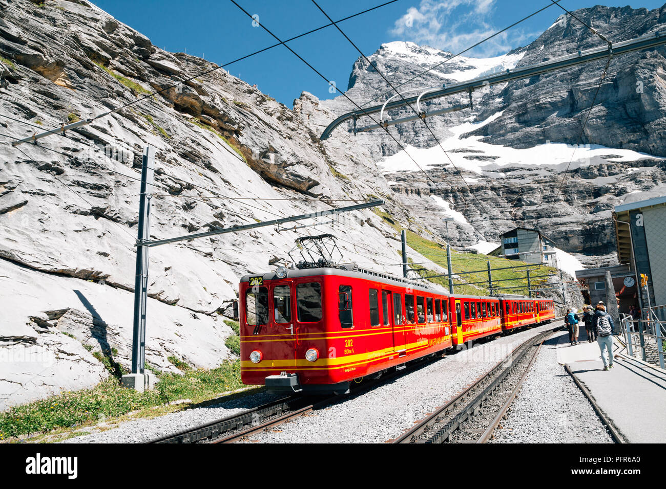 Switzerland - August 22, 2016 : Eigergletscher train station platform with snowy mountain - Stock Image