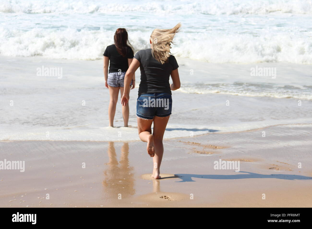 Hot summer day in Dana bay, as we say goodbye to the ocean for now, enjoying every last bit of sand sea and silliness. - Stock Image