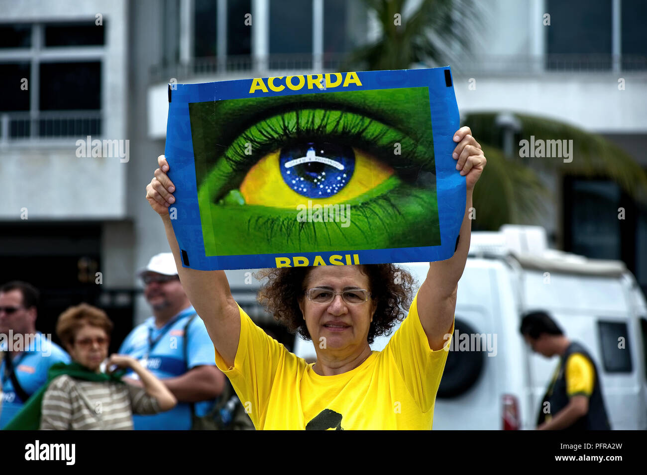 Copacabana, Rio de Janeiro – December 4, 2016: A protester holds a sign that says 'Wake up Brazil' in Portuguese during a march against corruption - Stock Image