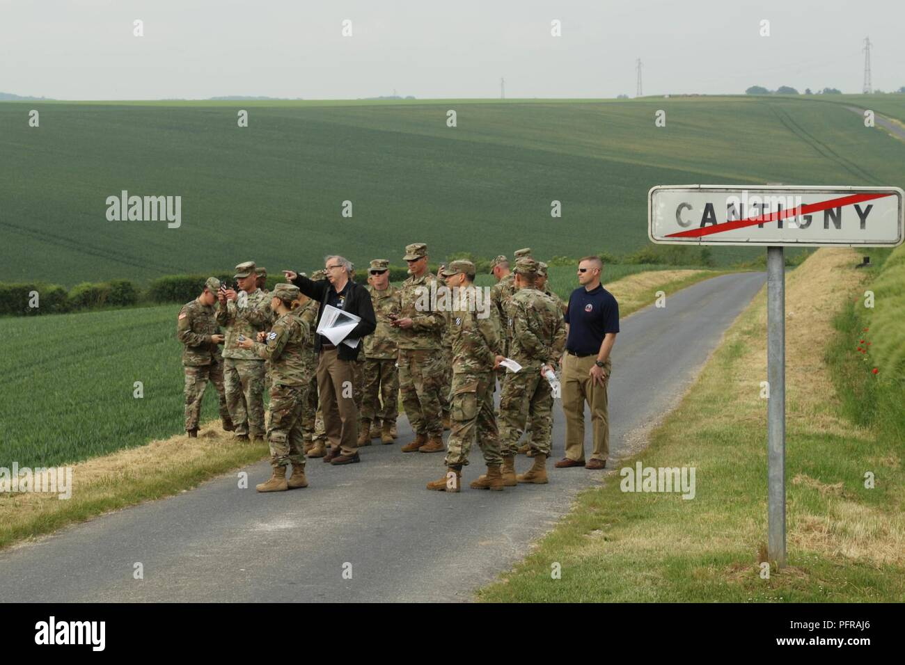 """Robert J. Smith. Fort Riley Museum Complex director and historian, leads a group of """"Big Red One"""" Soldiers including Maj. Gen. Joseph M. Martin, 1st Infantry Division and Fort Riley commanding general, during an educational tour of Cantigny, France on May 24, 2018. The battle of Cantigny served as the first test of the U.S. military during WWI, and the first time that the 1st Inf. Div. took to the field in combat. - Stock Image"""