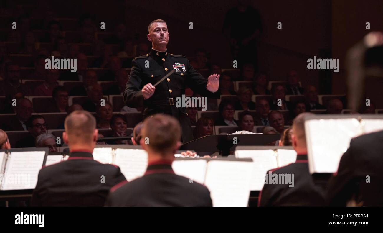 """Chief Warrant Officer 3 Michael J. Smith, officer In charge of 2nd Marine Division Band, conducts the band at the """"Concert Hall de Soissons"""" in Soissons, France, May 25, 2018, as part of the Battle of Belleau Wood centennial ceremony weekend. This significant event takes place over Memorial Day weekend where we reflect upon and honor the legacy of service members who gave their lives in defense of the nation and pay homage to their ultimate sacrifice. (Marine Corps - Stock Image"""