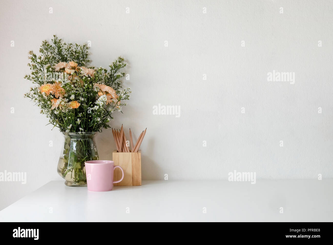 Stylish Workspace With Poster Book And Flower Bouquet Workplace