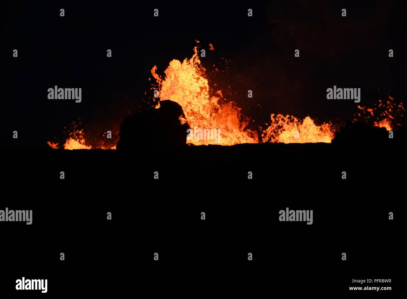 Fissure number seven throws lava into the night air over Leilani Estates, May 26, 2018. (Air National Guard - Stock Image