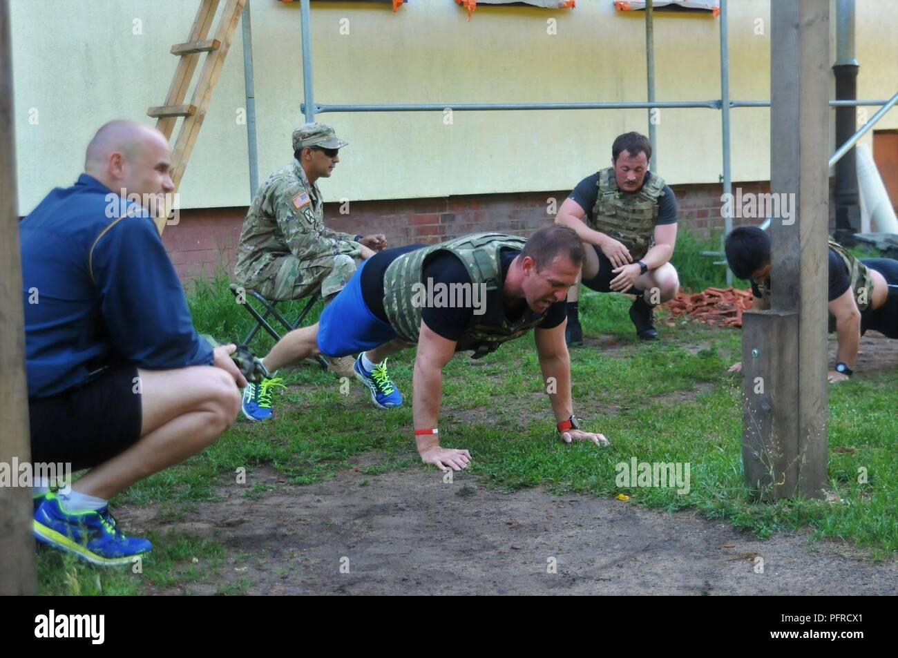 Battle Group Poland Soldiers remember Memorial Day by competing in the Murph Challenge in honor of the fallen who gave the ultimate sacrifice in defense of the nation on Bemowo Piskie Training Area, on May 28, 2018. These Soldiers are part of the unique, multinational battle group comprised of U.S., U.K., Croatian and Romanian soldiers who serve with the Polish 15th Mechanized Brigade as a deterrence force in northeast Poland in support of NATO's Enhanced Forward Presence. Stock Photo
