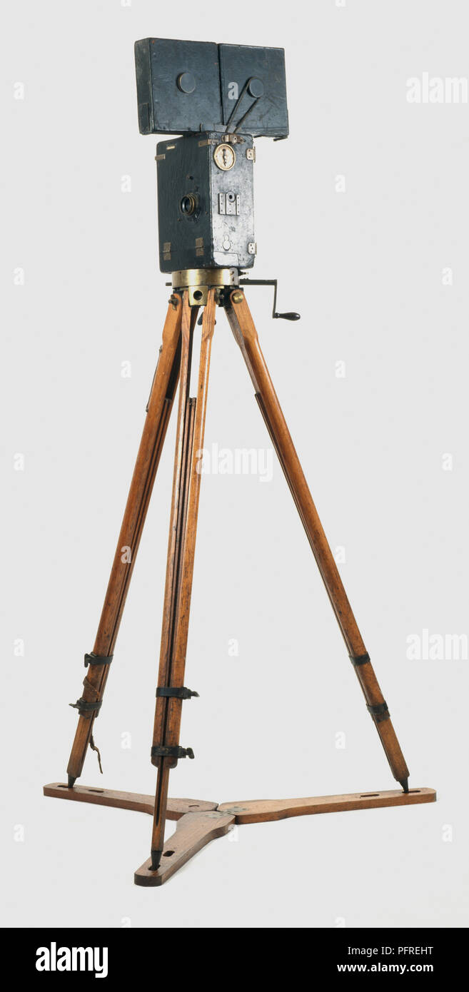 French Pathe silent movie camera with hand-crank on wooden tripod. - Stock Image