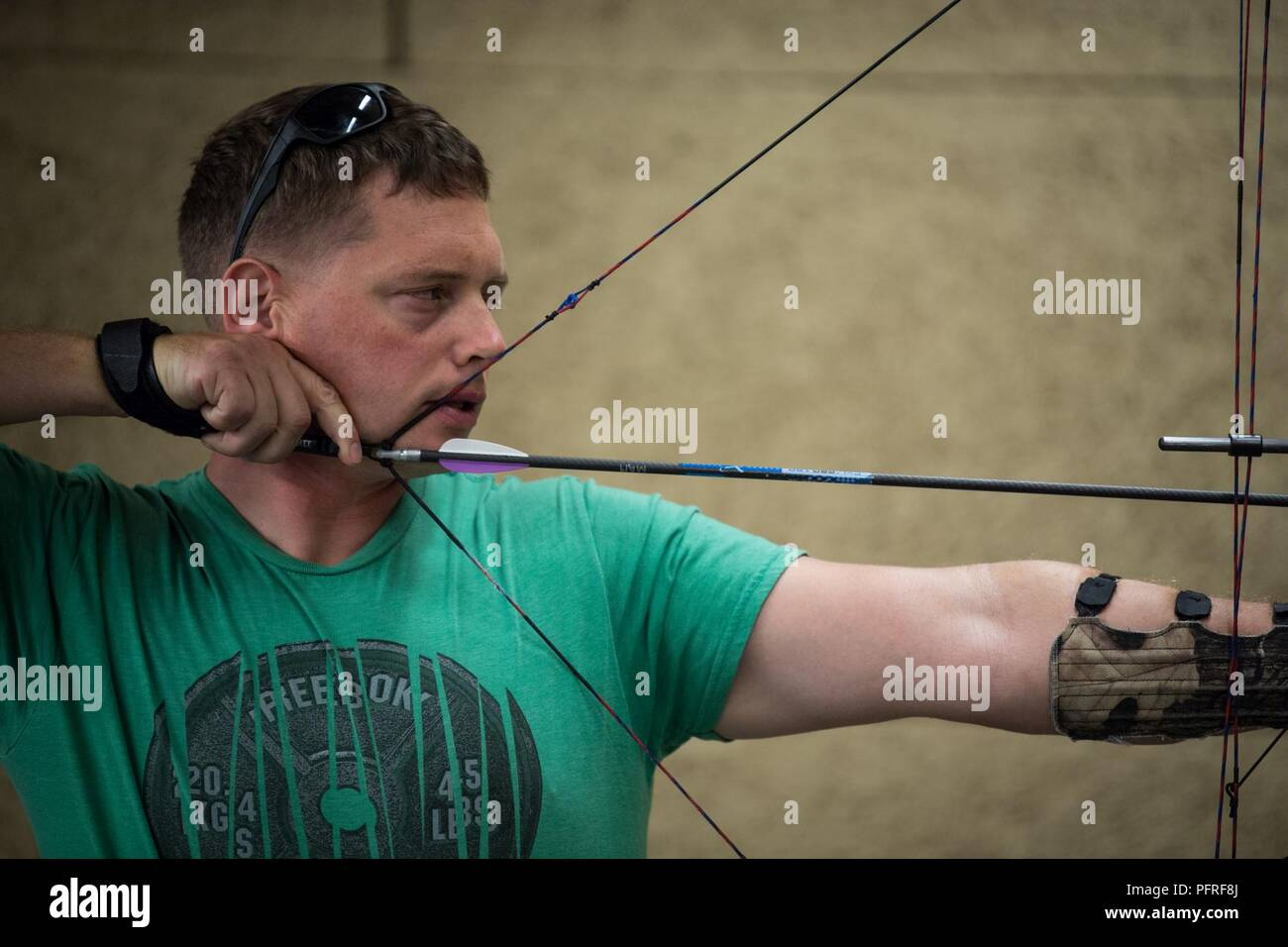 9968a92d74 U.S. Marine Corps Sgt. Mark Monroe aims downrange during a 2018 DoD Warrior  Games archery