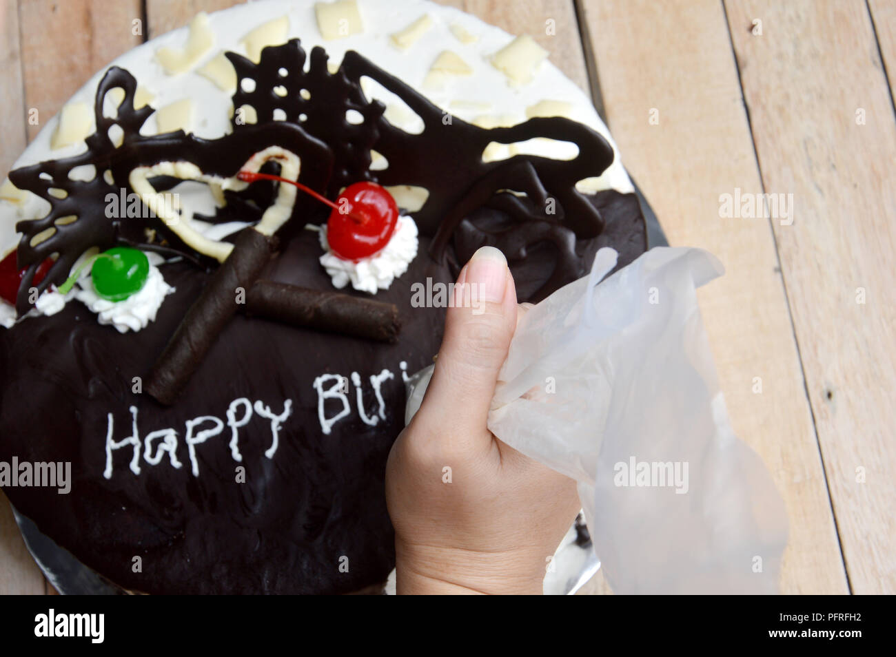 Awe Inspiring Woman Hand Writing At Birthday Cake On Wooden Table Stock Photo Funny Birthday Cards Online Sheoxdamsfinfo