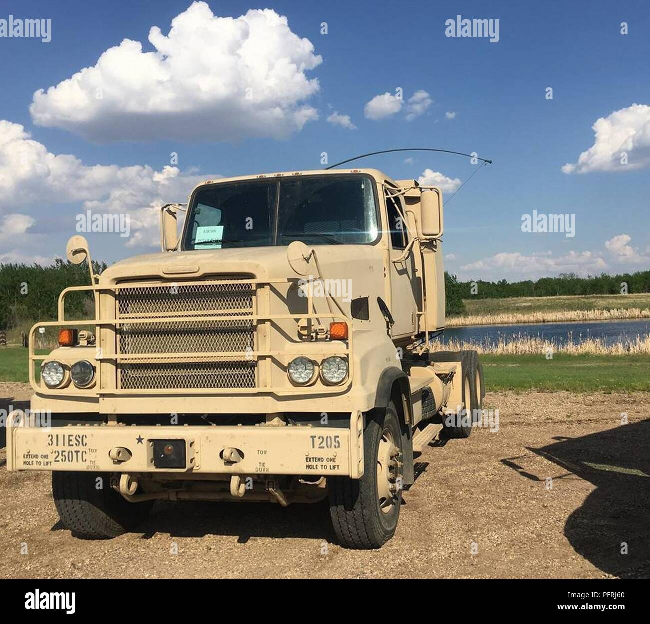 An M915A5 belonging to the U.S. Army Reserve 250th Transportation Company staged next to a lake at the Canadian Manoeuvre Training Centre, Wainwright, Alberta, Canada. - Stock Image
